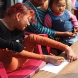 girl-writing-with-toes-gurkha-peace-foundation